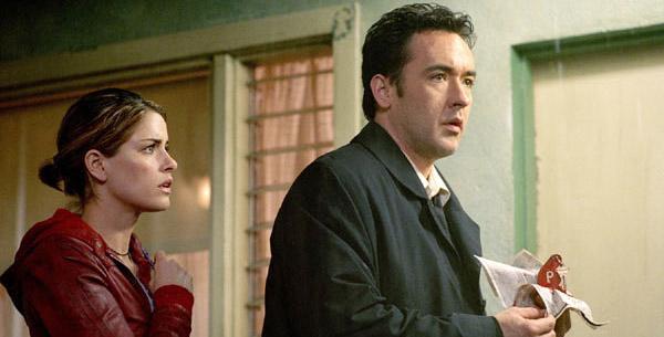 Amanda Peet et John Cusack confinés dans un motel de Los Angeles