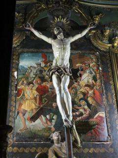 Le tableau « La montée au calvaire », visible dans la latérale droite de l'église de l'Immaculée Conception à Bastia, derrière le Christ en croix.