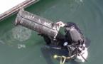 Des huitres sont placées dans le port de Bastia. Elles capteront dans leur coquilles les polluants.